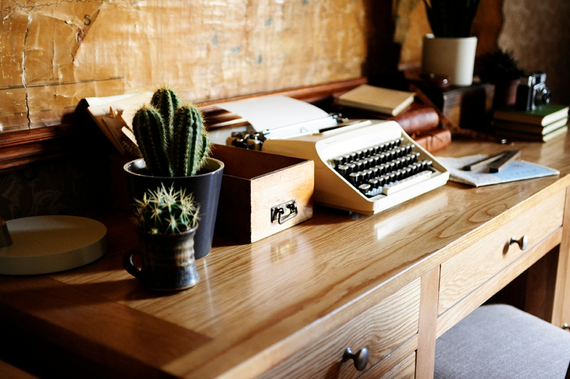 Desk typewriter letters cacti map
