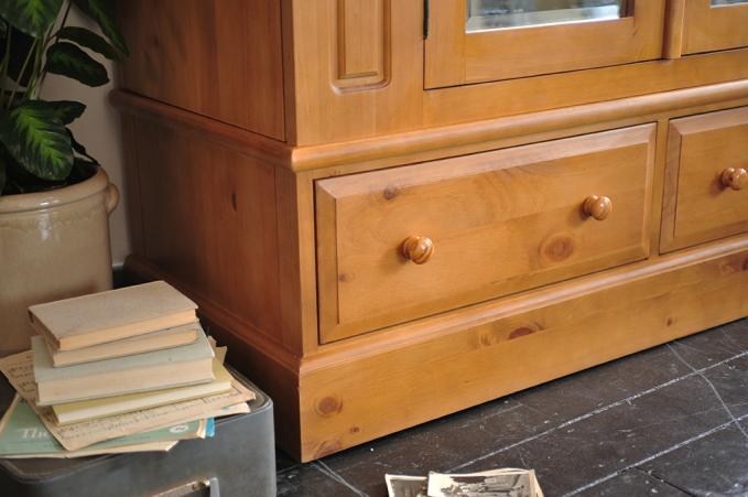 Drawer space, pine wardrobe with mirror, books, vintage suitcase, wooden floor