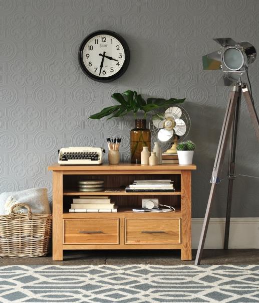 Geometric patterns, oak tv unit, tripod hitchcock lamp, vintage fan, oak furniture, typewriter, white camera, cacti