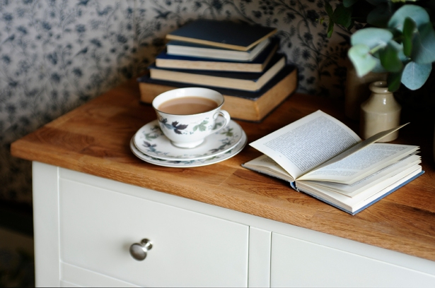 Books on white chest of drawer ,Vintage tea set