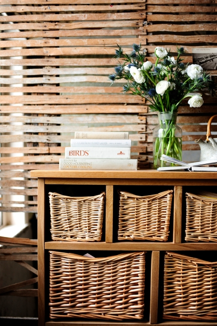 Books, wicker, farmhouse, exposed wall, thistles, roses