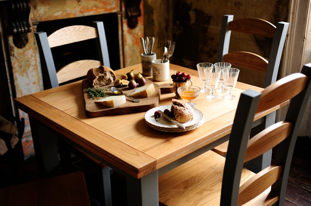 Dining table, bread, figs, fruit, glasses, cutlery, honey, cherries, cheese, breadboard, rustic