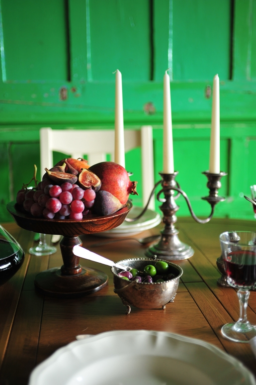 Fruit, candelabra, olives, wine, dining