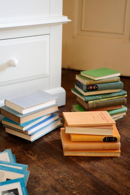 green books, yellow books, blue books, white painted furniture