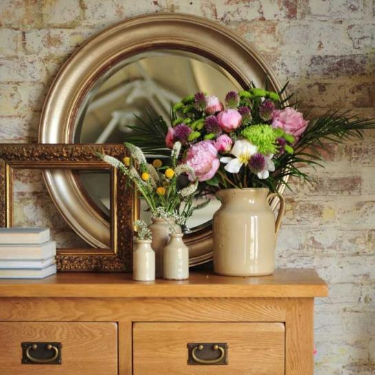 Hall mirror, round mirror, flowers, gold frame, books