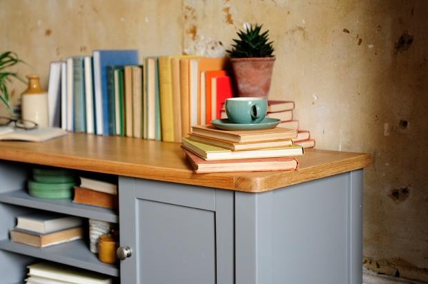Multicolour books, grey furniture