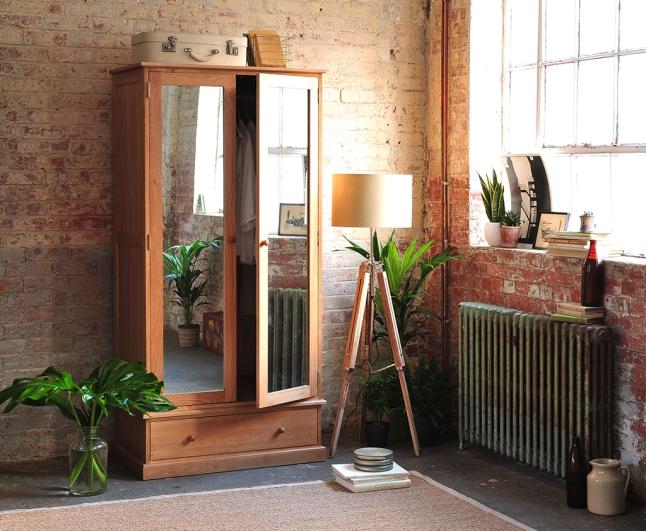 Oak bedroom furniture, Mirrored wardrobe, tripod lamp, exposed brick wall, iron radiator