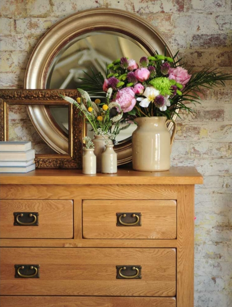 Oak chest of drawers, brick wall, dream bedroom, oak bedroom furniture