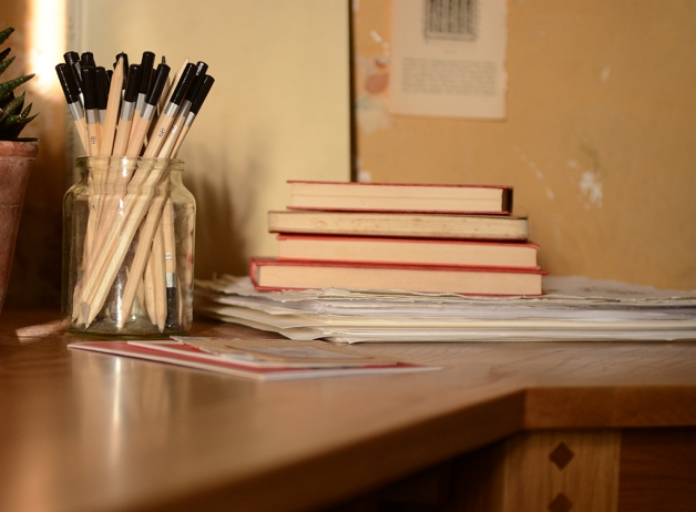 Oak desk, home office, pencils, books, paper
