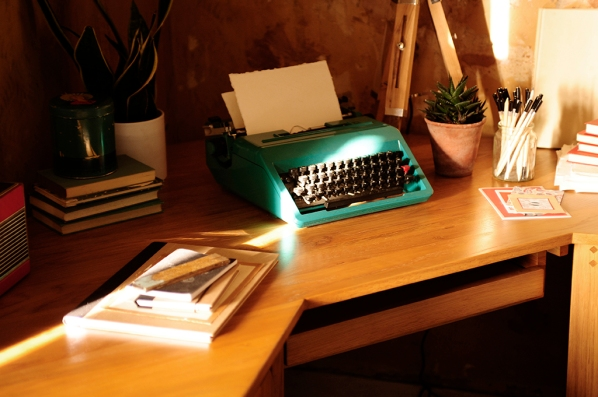 Oak desk, home office, typewriter, pencils, notepads