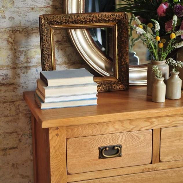 Oak furniture, oak chest of drawers, oak grain, books, vintage vases, antique gold frame