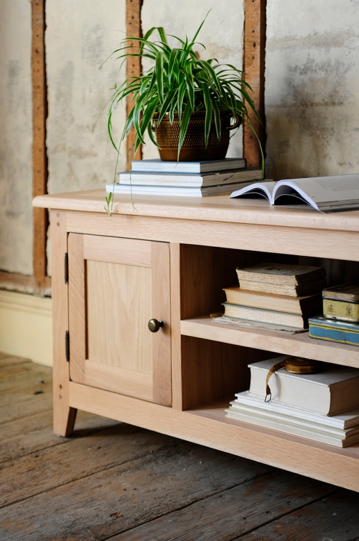 Oak TV unit, plant, rustic, books, vintage tin, wooden floors