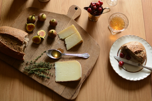 Rustic dining, cheese, chopping board, rustic bread, figs, honey, cherries, thyme