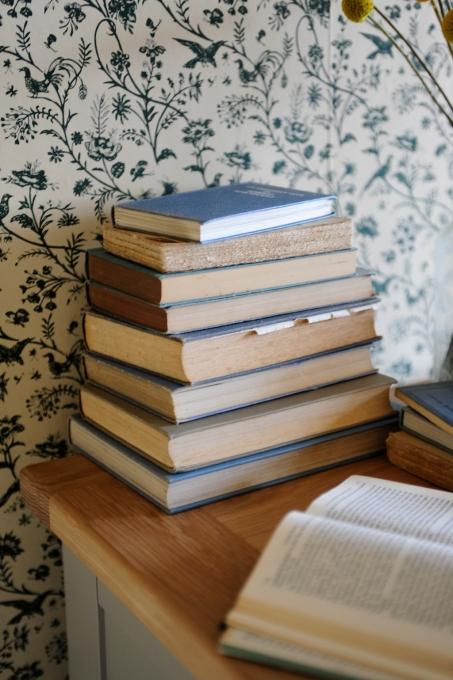 stack of books, blue books, laura ashley wallpaper, Oak furniture