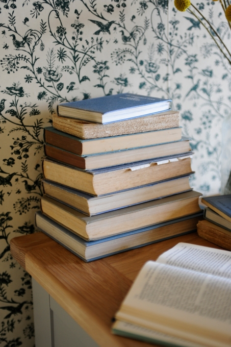 stack of books, blue books, laura ashley wallpaper, Oak furniture
