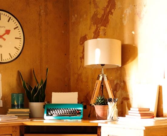 Tripod lamp, typewriter, plant, newgate clock