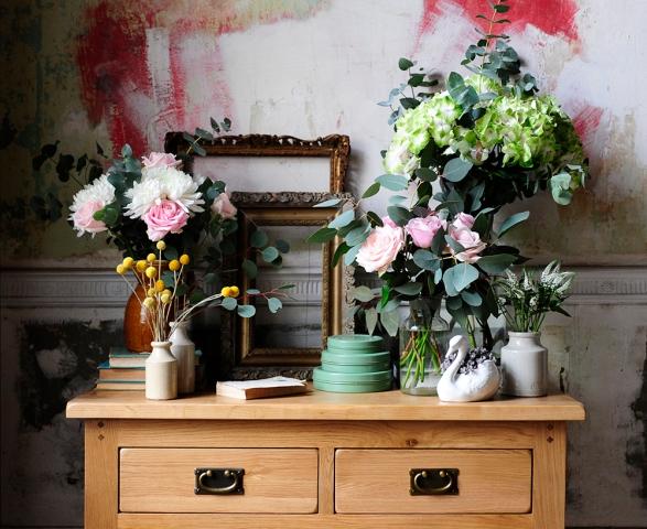 Abundance of flowers, roses, succulent, gold frames, textured walls