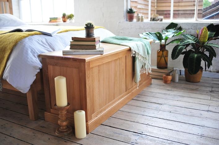Bedroom storage, candles, green accessories, white linen, dream bedroom