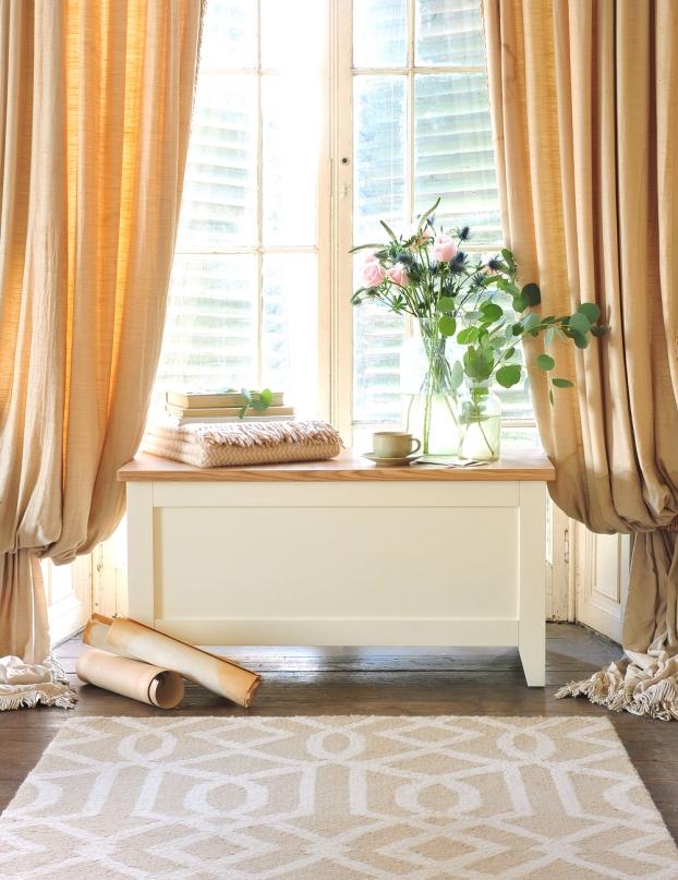 Blanket box, geometric rug, flowers, vintage curtains