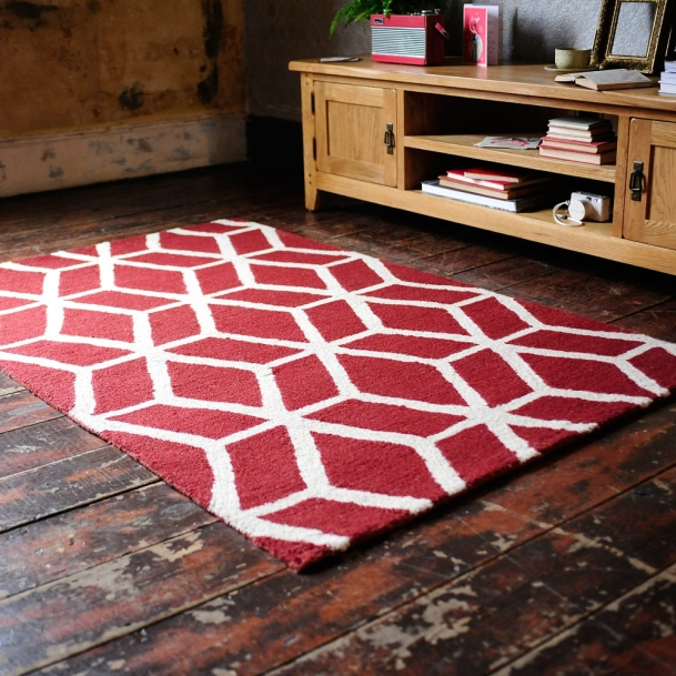Bold rug, geometric, red, wooden floors