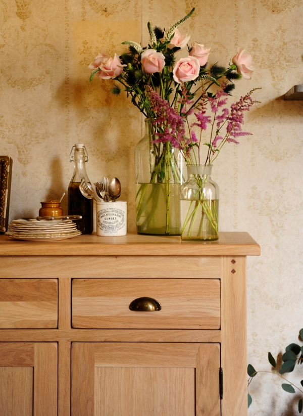 Flowers, oak furniture, roses, eucalyptus, sideboard