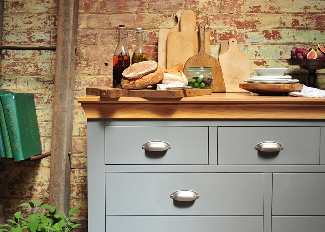 Grey chest, grey furniture, food, oils, bread, wooden chopping boards