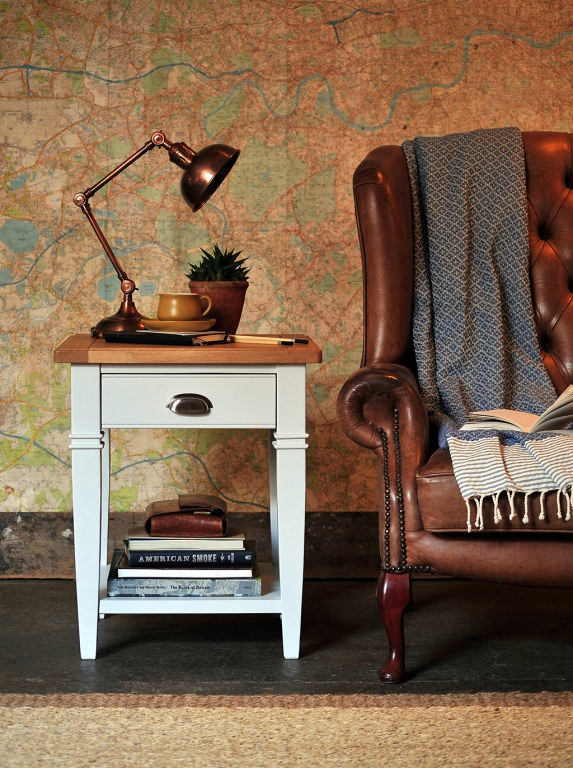 Grey lamp table, leather chair, books, copper lamp, vintage map
