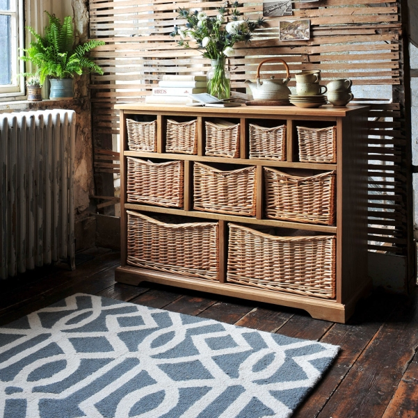 Grey rug, wicker storage, geometric pattern, modern, rustic