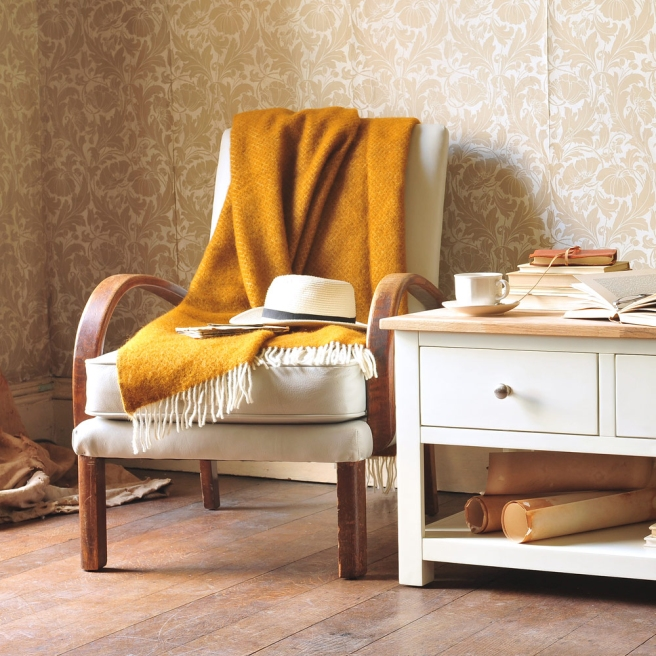 Hat on chair, mustard throw, vitage wallpaper, coffee table, selling houses