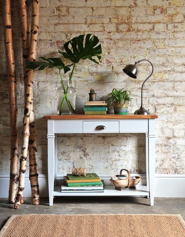 Light grey sideboard, grey furniture, botanical, exposed brick wall
