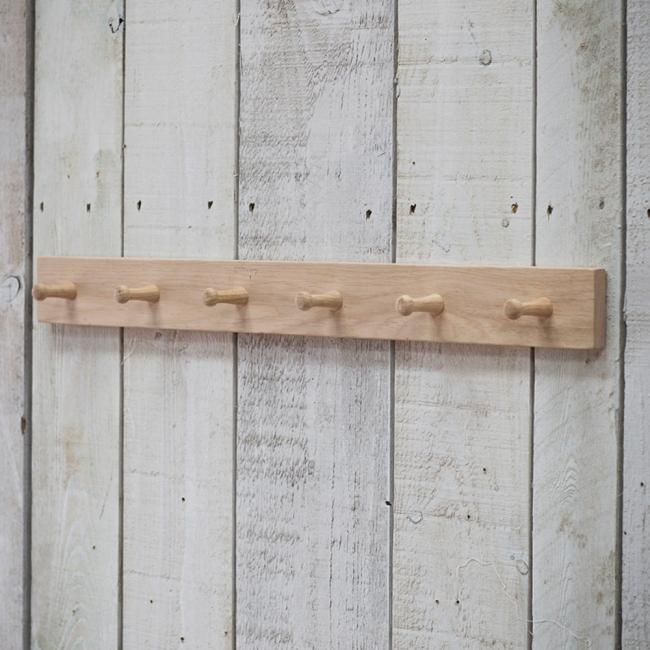 Peg rail, peg board, hanging rail, wooden peg rail