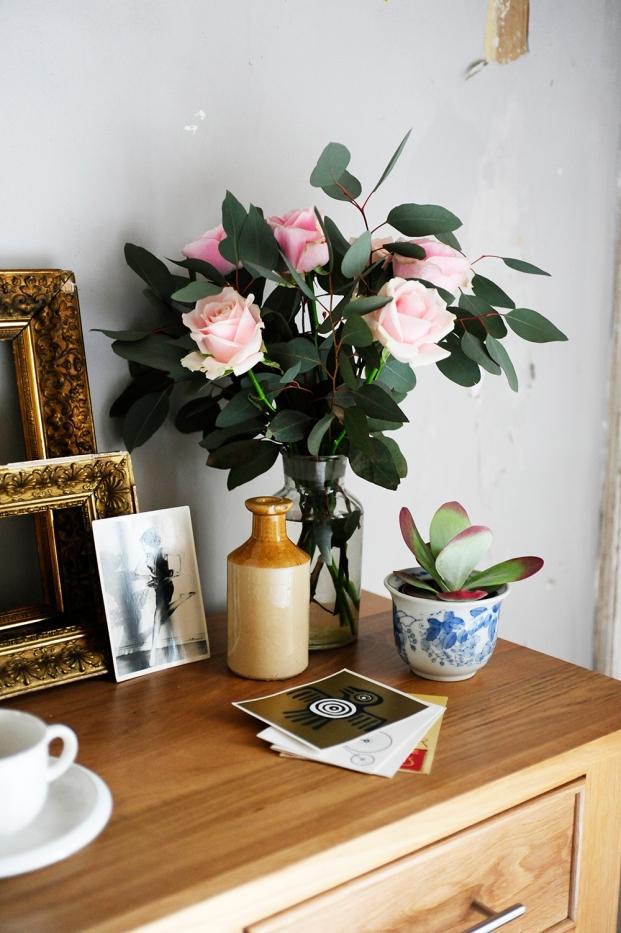 Pink roses, succulent, gold frames, eucalyptus