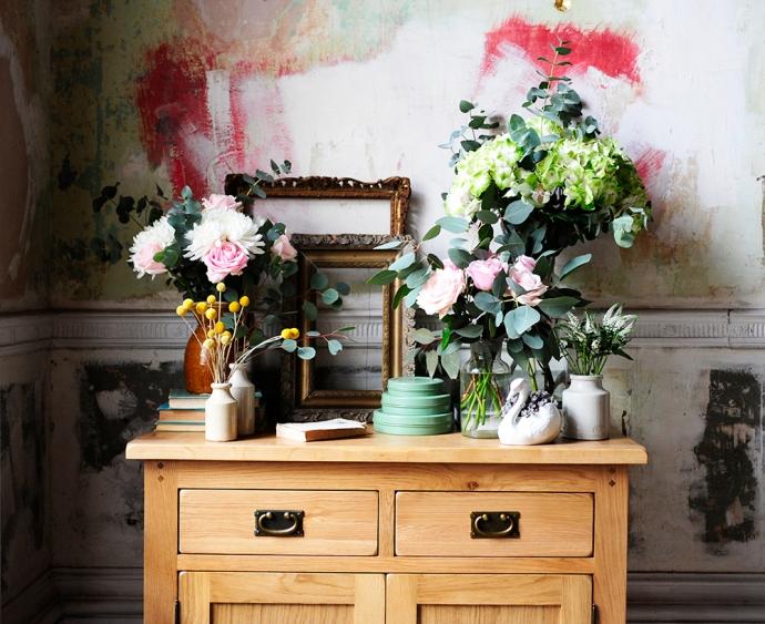 Abundance of flowers, roses, hydrangers, veronica, succulents, ceramic swan, vintage vases