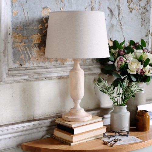 Lamp, flaking wall, books, flowers