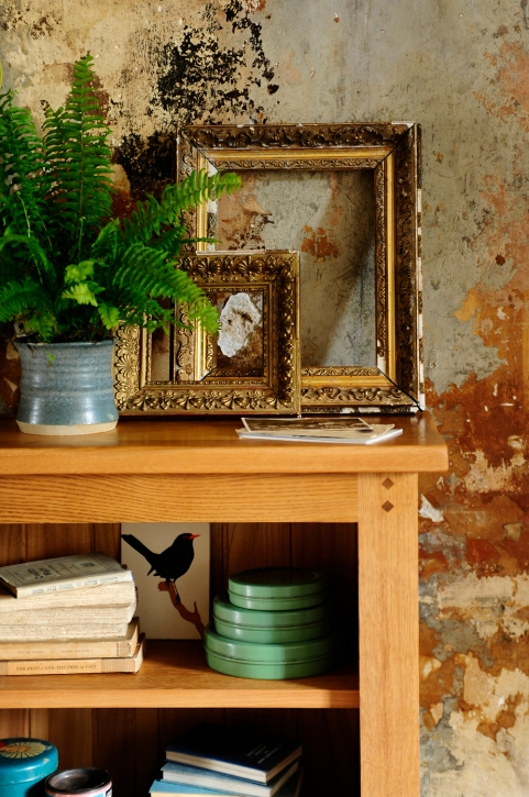 Oak bookcase, rustic oak, rustic wall, antique golden frames, blue pottery
