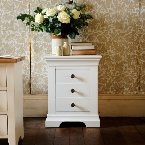 White bedside table, white furniture, vintage wallpaper, books, earthernware, roses