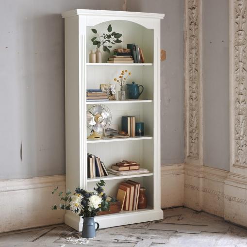 White bookcase, blue books, vintage fan, modern rustic