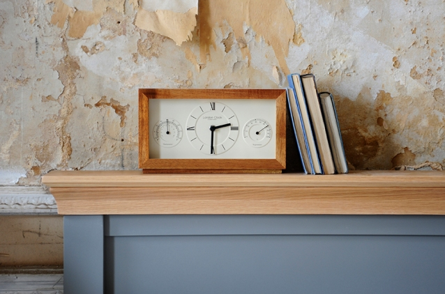 Wooden clock, books, bedroom, grey bed, vintage wall paper2