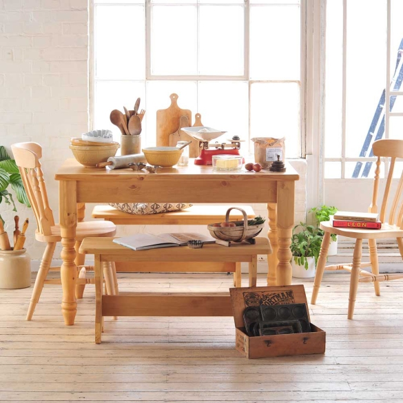 Country kitchen, baking, wooden chopping boards, flour, pine table