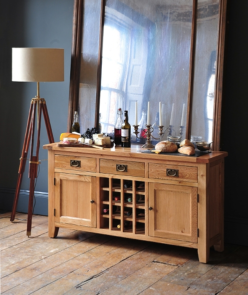 Oak sideboard, wine rack, cheese, wine, candelabra