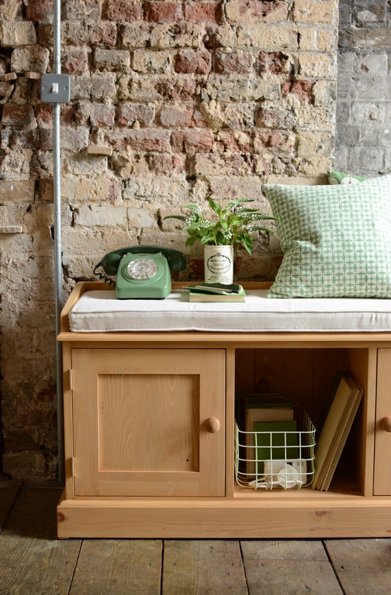 Pine hall bench, pine shoe storage, green cushion, books
