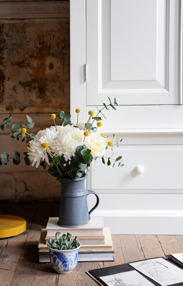 White furniture, white wardrobe, wooden floor, succulents, roses, craspedia, eucalyptus