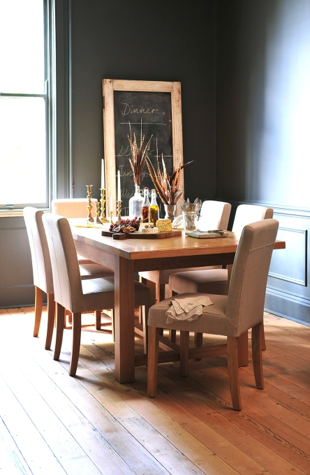 Cream leather chairs, oak table, grey walls, feathers, blackboard