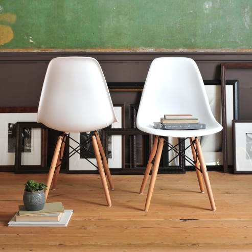 Eames style chairs, wooden floor, green wall, in detail book