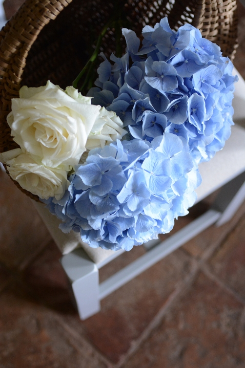 Hydrangeas in a basket, roses, country kitchen, stone floor