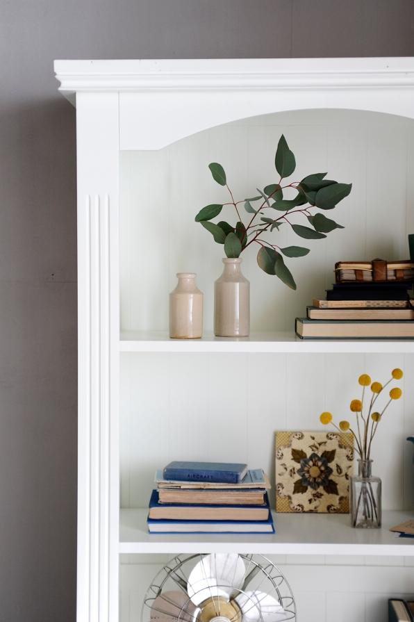 bookcase-beauty-eucalyptus-craspedia-vintage-tiles-vintage-bookswhite-bookcase