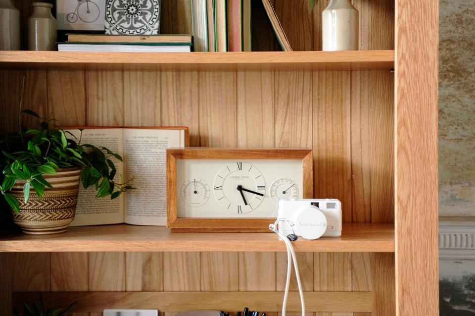 bookcase-display-oak-bookcase-clock-books-plants