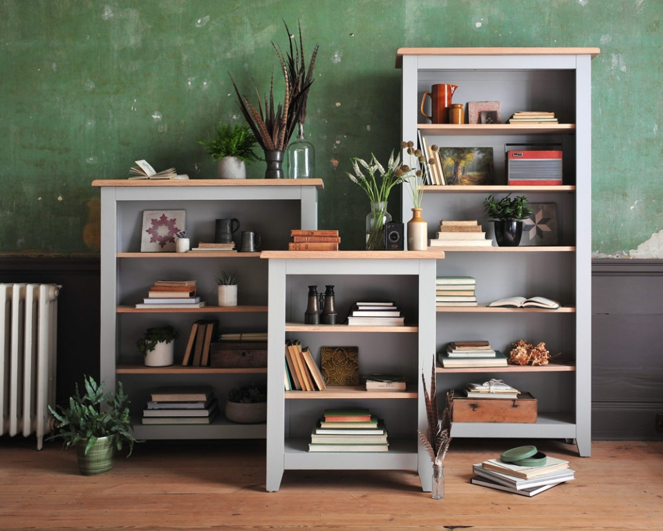 grey book cases, grey furniture, green walls, wooden floor